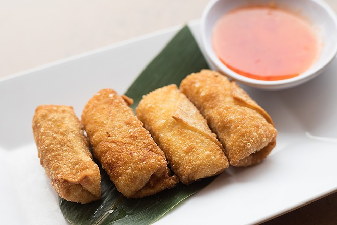 Blue crab Rangoon is made with real crab meat and served with sweet chile sauce. - MABEL SUEN
