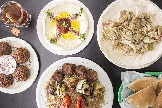 A selection of items from Worldwide International Market: hummus, chicken shawarma sandwich, falafel and combo plate. - PHOTO BY MABEL SUEN