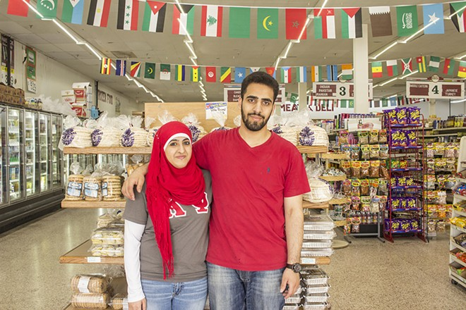 Siblings Ayah and Mohamad Sumren in the grocery store, which sells the family's from-scratch breads. - PHOTO BY MABEL SUEN