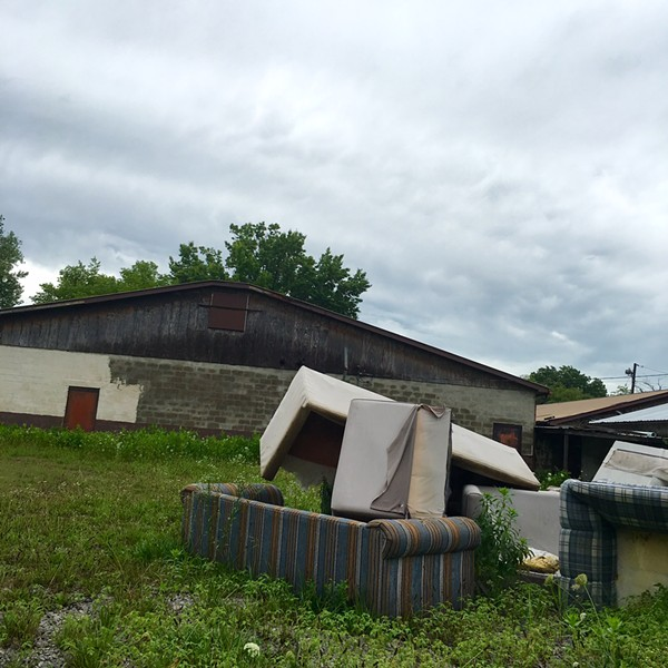 """The couches that previously graced the """"couples theater"""" now form a sad pile behind the building. - PHOTO BY THOMAS CRONE"""