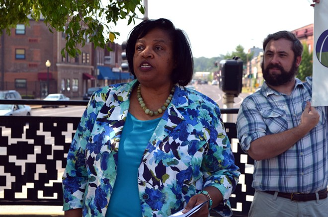 St. Louis Equal Housing and Reinvestment Alliance's co-chair Jackie Hutchinson speaks about redlining at a gathering in north St. Louis county's Baden neighborhood. - KAVAHN MANSOURI