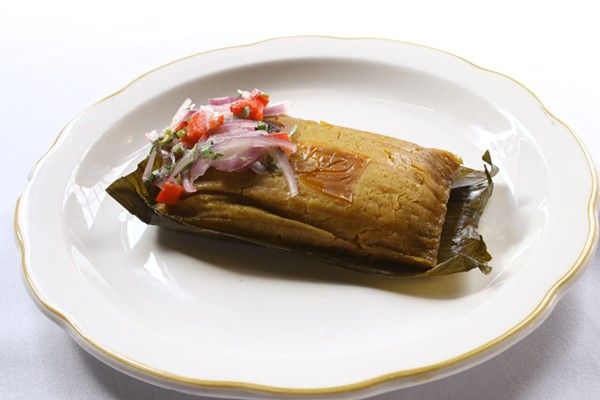 Tamal de Pollo: a Peruvian chicken tamale served with red onion salad. - CHELSEA NEULING