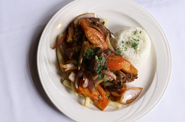 Lomo Saltado: Sauteed tenderloin steak, served with onions, tomatoes, rice and fries. - CHELSEA NEULING