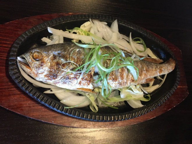 The yellow corvina grilled fish. - PHOTO BY EMILY MCCARTER