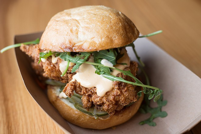 Brasswell's chicken sandwich is topped with arugula and Crystal aioli. - MABEL SUEN