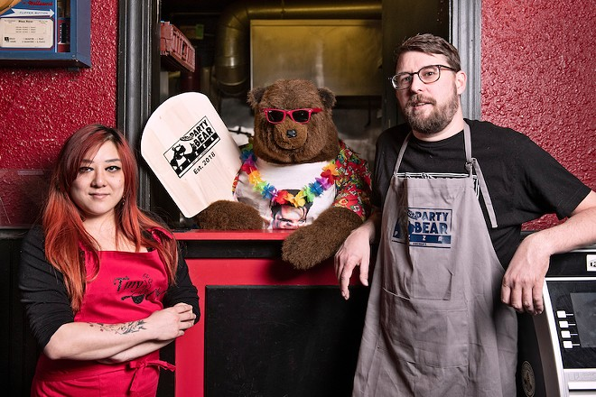Melanie Meyer, left, and Chris Ward with their new eatery's eponymous mascot. - COREY WOODRUFF