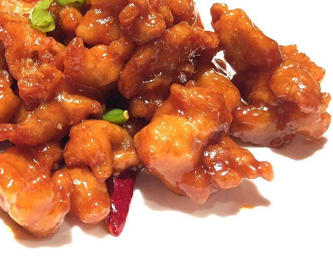 General Tso's chicken with sugar snap peas. - PHOTO BY KEVIN KORINEK