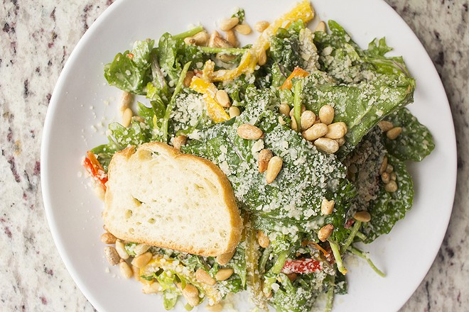 The baby kale salad with shaved parmesan, toasted pine nuts, roasted peppers and lemon-anchovy vinaigrette. - PHOTO BY MABEL SUEN
