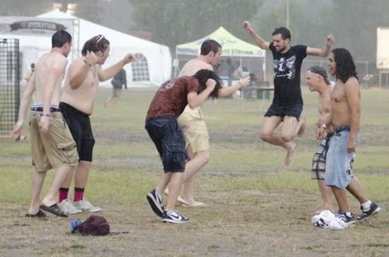 Rain-dancing festival goers at 2012's LouFest. - KHOLOOD EID