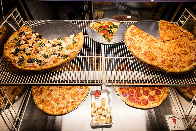 Pizza is available as a whole pie or by the slice. - MABEL SUEN