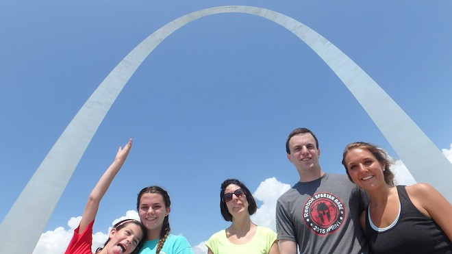 Runners enjoy the view from the Arch. - COURTESY OF ST. LOUIS RUNNING TOUR