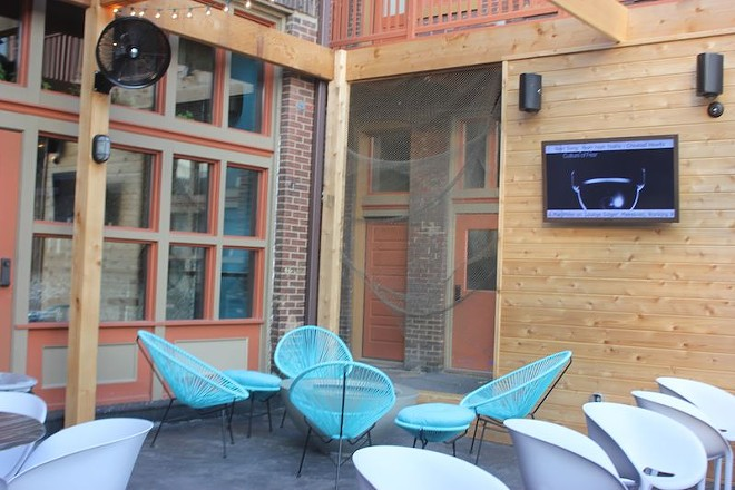 An enclosed patio out back welcomes drinkers with two big flat-screen TVs and plenty of seating. - PHOTO BY SARAH FENSKE