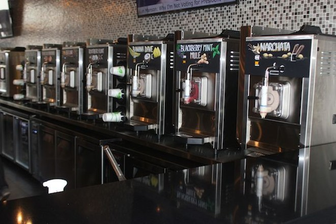 A row of slushie machines at Narwhal's. Twelve options are offered at any given time. - PHOTO BY SARAH FENSKE