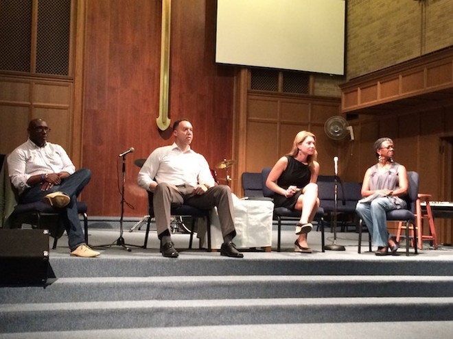 Panelists at last night's town hall meeting included Rev. Willis Johnson, NAACP member Redditt Hudson, ACLU lawyer Julie Eberstein, and Ferguson resident Judy Shaw. - PHOTO BY JESSICA KARINS