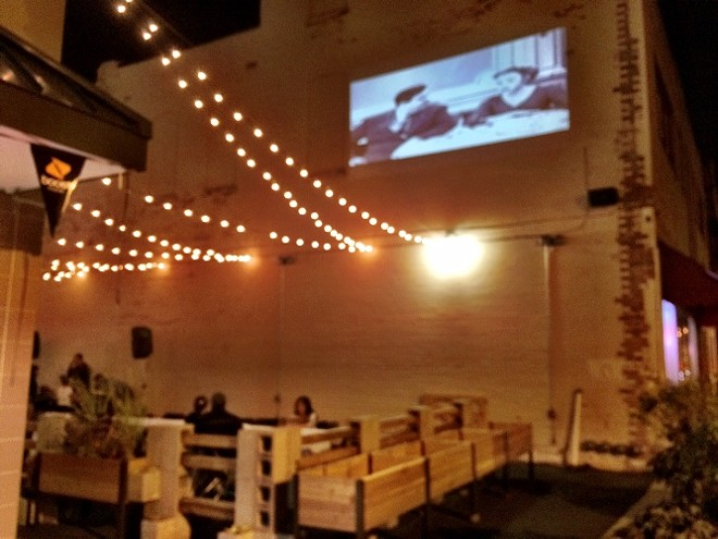 SIDE PATIO AND MOVIE PROJECTION | SARA GRAHAM