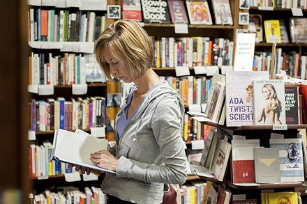 A patron browses the stacks at Subterranean. - PHOTO BY KELLY GLUECK