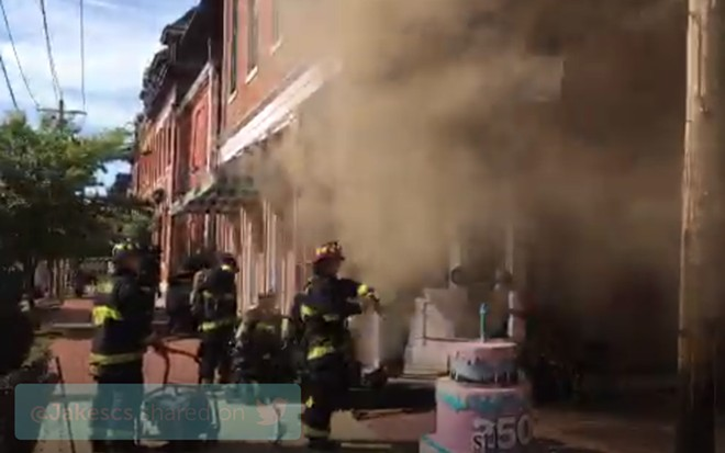 Firefighters work to put out a fire at Sweet Divine in Soulard. - IMAGE VIA ST. LOUIS FIRE DEPARTMENT/PERISCOPE