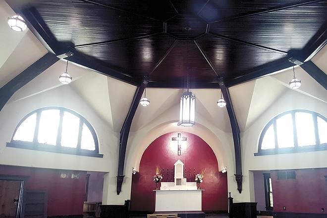 After John Brown sold the church earlier this month, the new owner set to work renovating the building. - PHOTO BY DANNY WICENTOWSKI