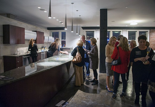 The Artists for a Cause fundraiser was held last week on the space's fourth floor. - PHOTO BY KELLY GLUECK