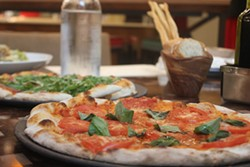 The Margherita, foreground, shows the classic Neapolitan charring. - PHOTO BY SARAH FENSKE