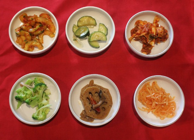 A few of the seemingly endless banchan, or side dishes, served at Wudon. - CHERYL BAEHR