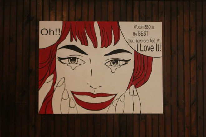 Comic-like paintings adorn Wudon's walls. - CHERYL BAEHR