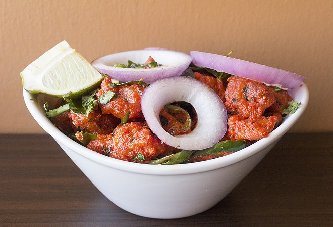 """""""Chicken 65,"""" a spicy, deep-fried chicken dish marinated with yogurt, chilis and Indian spices. - PHOTO BY MABEL SUEN"""