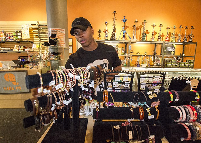 Williams browses some items at Tabo-Co, a smoke shop and novelty gift store. - PHOTO BY MABEL SUEN