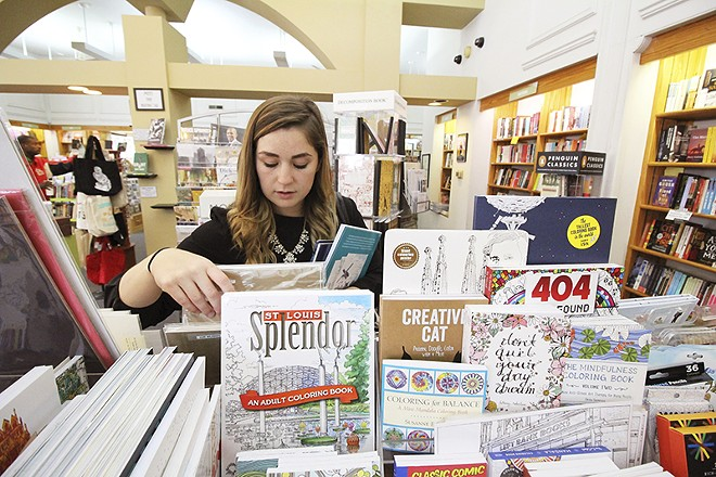 Diaz picks out a St. Louis-themed coloring book at Left Bank Books. - PHOTO BY MABEL SUEN