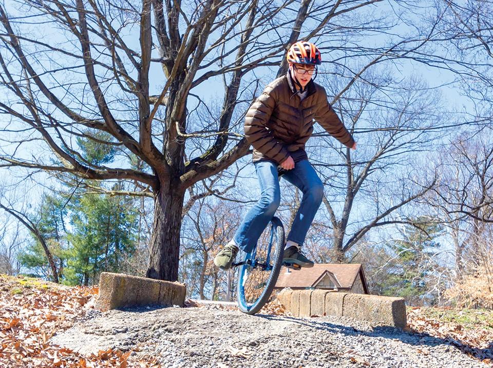 Austin Calzada descends a rocky path at Tilles Park.