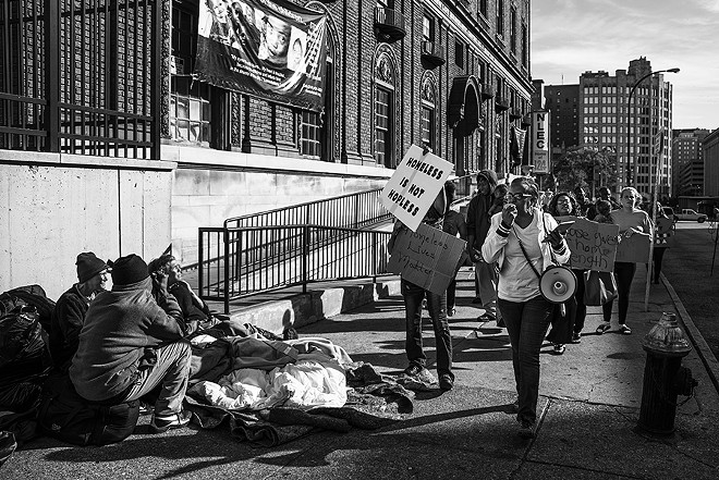BB Phillips, right, leads a group of homeless advocates during a rally in support of the New Life Evangelistic Center on November 17. - PHOTO BY NICK SCHNELLE