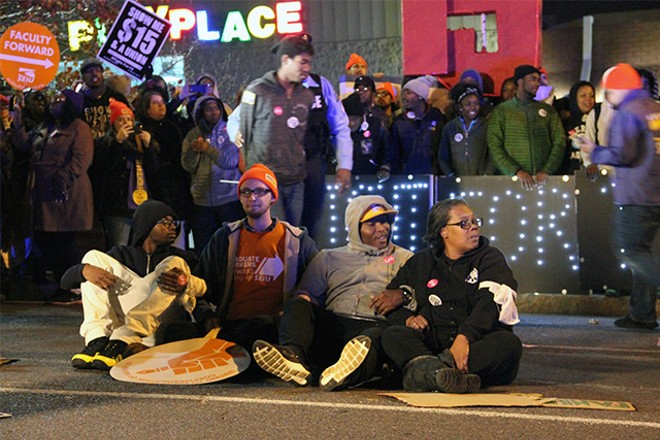The 30 or so protesters arrested were released after a couple hours, organizers say. - PHOTO BY DANNY WICENTOWSKI