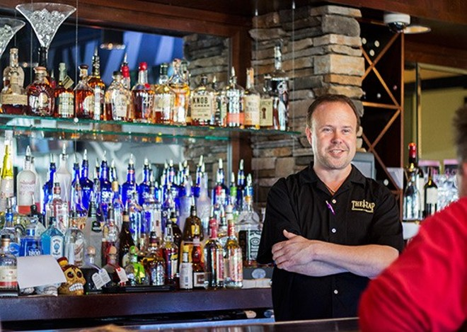 Jerry Berhorst behind the bar at The Tap Restaurant + Brewery in happier times. - PHOTO BY MABEL SUEN