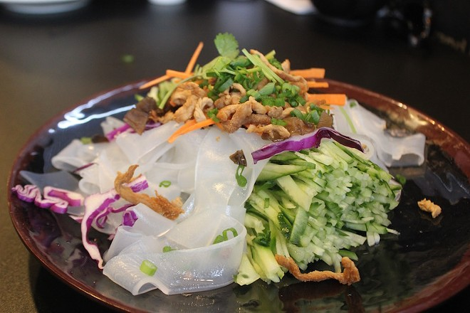 The clear noodles with special sesame sauce. The noodles are cold and delicious with the sauce, cabbage and bits of pork all mixed in. - PHOTO BY SARAH FENSKE