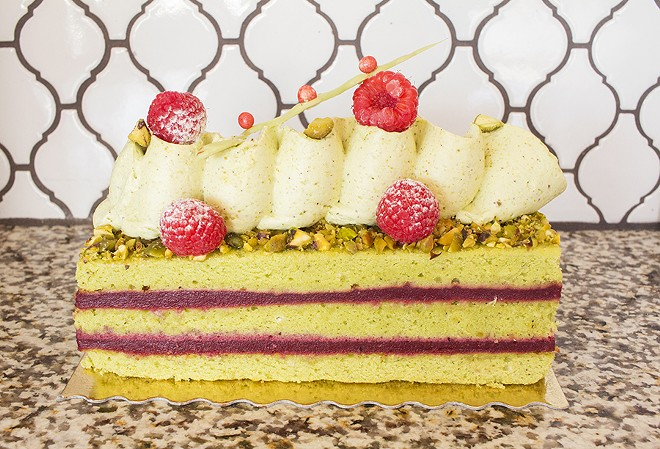 The Jarmo yule log features pistachio cake, pistachio cream and strawberry coulis. - PHOTO BY MABEL SUEN