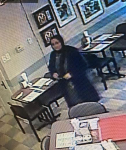 This woman stole 'a large sum' of money while her accomplices covered her, police say. - IMAGE VIA ST. LOUIS POLICE