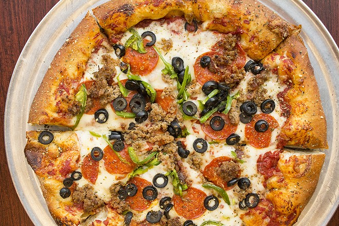 """The """"Humble Pie"""" features pepperoni, sausage, green peppers, black olives and white onions. - PHOTO BY MABEL SUEN"""