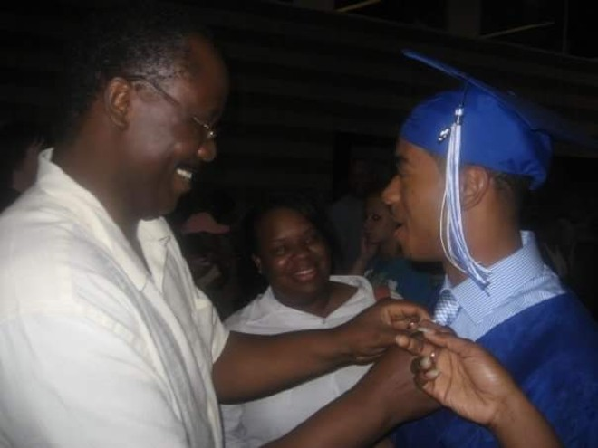 Jordan Nichols, currently serving 15 years in prison, shown here after his high school graduation with his mother and stepfather. - PHOTO COURTESY OF NICHOLS FAMILY.