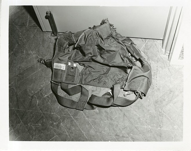Having never used a parachute before, McNally needed outside help to get into the harness. - NATIONAL ARCHIVES AT KANSAS CITY