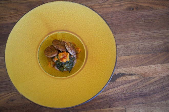 Pork sous, collard greens, acorn crisps and carrot chow chow. - CHERYL BAEHR