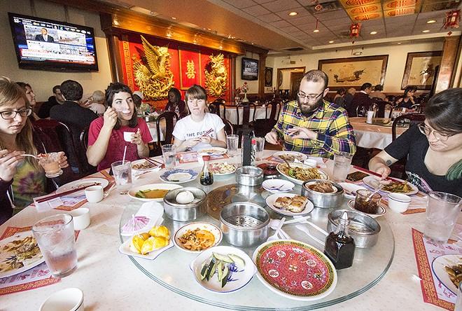 Friends enjoy a dim sum feast. - PHOTO BY MABEL SUEN