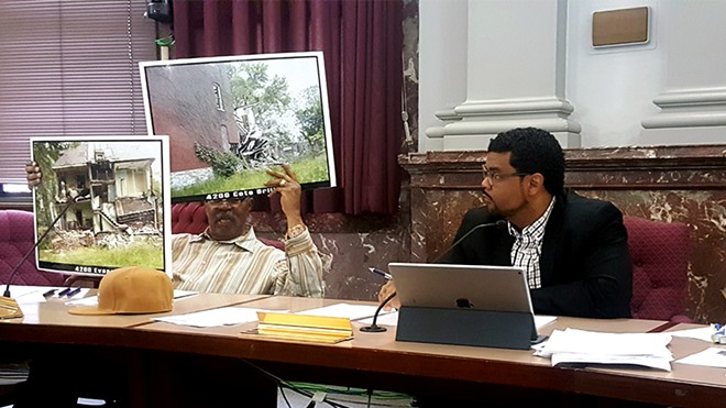 During Thursday's committee hearing, 4th Ward Aldermen Sam Moore, left, brought pictures of crumbling north city houses. - PHOTO BY DANNY WICENTOWSKI