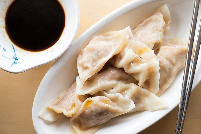 Taiwanese dumplings are served with a soy dipping sauce. - MABEL SUEN