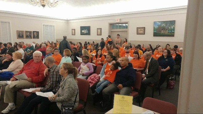 Orange-shirted pro-pit activists filled multiple rows at Florissant City Hall. - PHOTO COURTESY OF MANDY RYAN