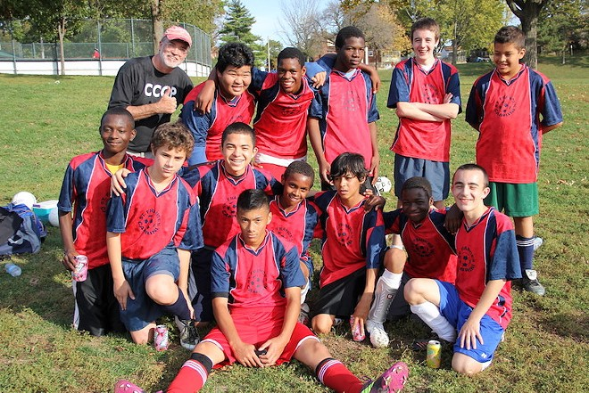 Coach DJ Wilson with a soccer team at Cabrini Academy, circa 2011. - THOMAS CRONE