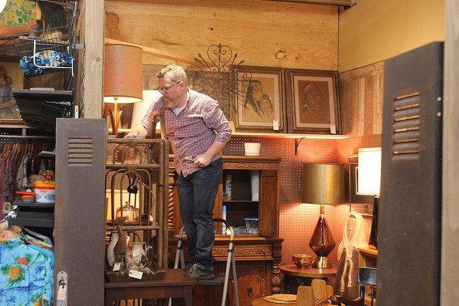 A vendor works to ready his space on Wednesday, April 24. - SARAH FENSKE
