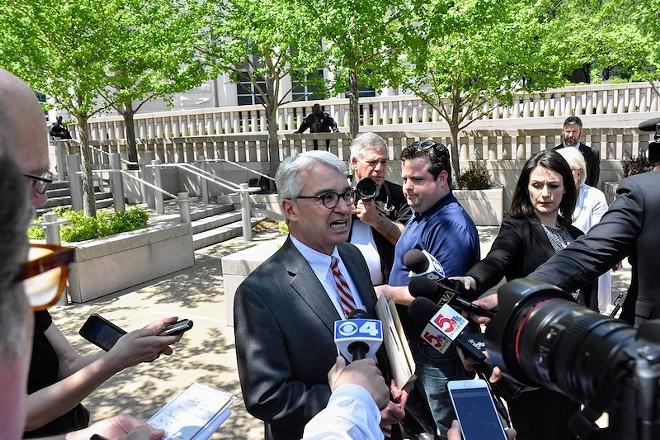 Assistant U.S. Attorney Hal Goldsmith addresses reporters. - DOYLE MURPHY