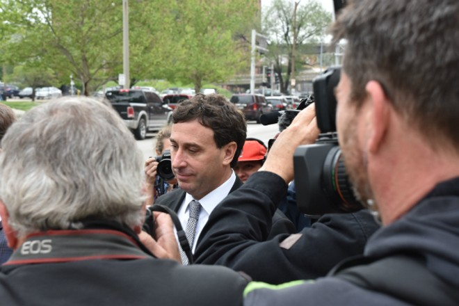 Ex-St. Louis County Executive Steve Stenger makes his way through reporters after pleading guilty to federal felonies. - DOYLE MURPHY