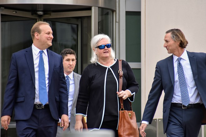 Sheila Sweeney leaves federal court with her attorneys after pleading guilty in a public corruption case. - DOYLE MURPHY