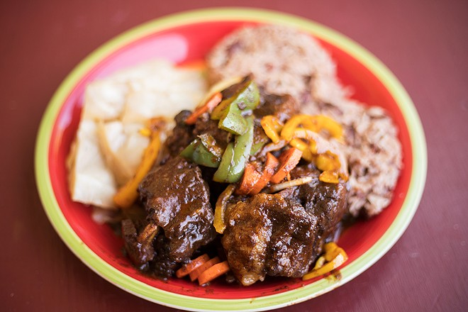 """""""Asher's Oxtail Entree"""" offers braised beef tails in a savory mixture of carrots, herbs and seasonings. - MABEL SUEN"""
